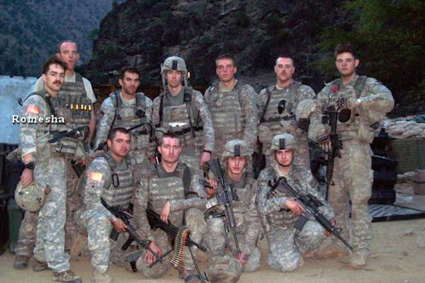 Members of Red Platoon, 61st Cavalry Regiment, including Staff Sgt. Clint Romesha (far left), after the battle of Combat Outpost Keating, 2009.