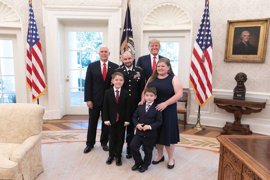 President Donald J. Trump and Vice President Mike Pence with Medal of Honor recipient Retired U.S. Army Staff Sgt. Ronald J. Shurer II, his wife Miranda, and sons Cameron and Tyler Monday, October 1, 2018, in the Oval Office of the White House. (Official White House photo by Shealah Craighead)