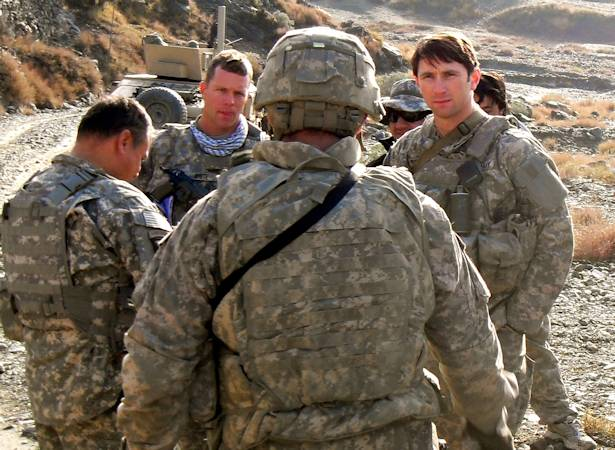 Capt. William D. Swenson (far right) talks with Soldiers while in support of the 10th Mountain Division (Light Infantry) in Afghanistan. Swenson served as an embedded trainer and mentor for the Afghan Border Police in 2009.