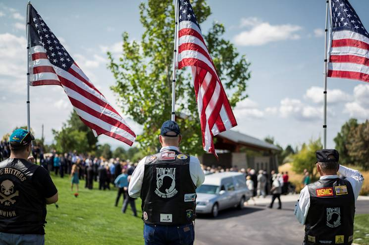 Patriot Guard members honor the late Col. Bernard Fisher, retired, a Medal of Honor recipient at Idaho State Veterans Cemetery Aug. 25, 2014, at Boise, Idaho. Fisher, who was born in San Bernardino, Calif., Jan. 11, 1927, grew up in Clearfield, Utah, and first called Kuna, Idaho, home after his discharge from the U.S. Navy V-6 program in 1946. (U.S. Air Force photo by Tech. Sgt. Samuel Morse)