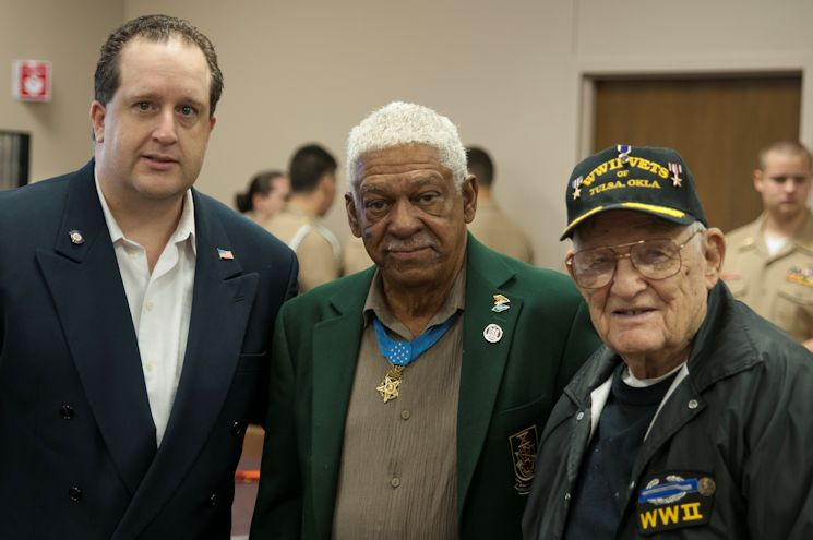 Oklahoma State Rep. Ken Walker (left), Sgt. 1st Class Melvin Morris (center), retired and Sgt. 1st Class Paul Andert, retired, during a veterans breakfast hosted of the Marine Corps League, Albert E. Schwab Detachment 875 in Broken Arrow, OK on April 26, 2014. Morris is being honored by the Tulsa based detachment of the Marine Corps League during the organization's Medal of Honor Day celebrations. (Photo by Sgt. Anthony Jones, 145th MPAD, Oklahoma Army National Guard)