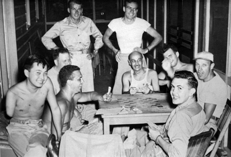 Army 2nd Lt. Daniel Inouye (front left) smiles with Bob Dole (front right) at Percy Jones Army Hospital in Battle Creek, Michigan, after the war. (Photo courtesy of Robert Dole Library)