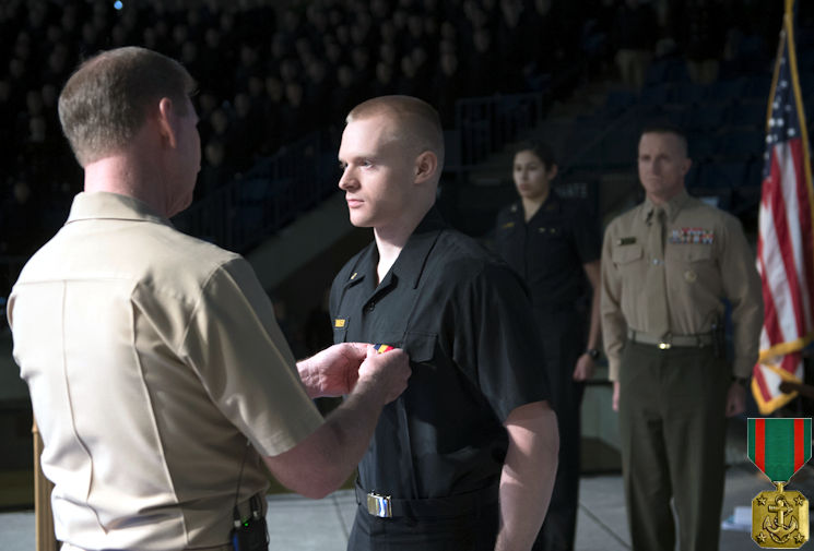January 9, 2017 - U.S. Naval Academy Superintendent Vice Adm. Ted Carter, left, pins the Navy and Marine Corps Medal on Midshipman 3rd Class Jonathan Dennler's uniform. Dennler received the medal - the highest non-combat decoration awarded for heroism by the U.S. Department of the Navy - for heroic actions while leading a Boy Scout troop in July 2016. During a major storm, two trees fell on the campsite, killing a scout and an adult volunteer and severely injuring others. When he couldn't contact anyone on the radio for help, he canoed more than 1.5 miles at night in 60 mph winds and a lightning storm to a ranger station to bring back help and medical supplies. (Image created by USA Patriotism! from U.S. Naval Academy photo by Kenneth Aston)
