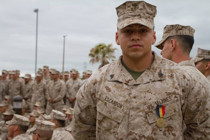 Cpl. Joshua Escandon, a field operator for 3rd Air Naval Gunfire Liaison Company, Force Headquarters Group, Marine Forces Reserve, was awarded the Navy and Marine Corps medal, April 14, 2013. Escandon, then a lance corporal, stopped a man from being stabbed to death by two assailants and was instrumental in saving that man's life and keeping the situation under control until the authorities arrived. (U.S. Marine Corps photo by Sgt. Michael Darnell)