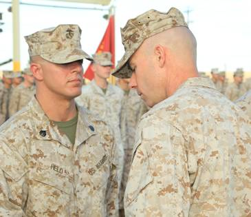 Staff Sgt. Jamie L. Held, platoon sergeant, Co. D, 1st Tank Battalion, is presented with a Navy and Marine Corps Commendation Medal by Maj. Andrew Dirkes, executive officer, 1st Tank Battalion, during an award ceremony Sept. 3,