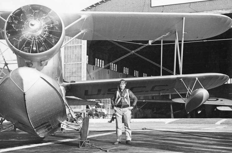 "Coast Guard Aviator Richard Burke ready to climb on board a waiting Grumman J2F ""Duck,"" one of the service's smaller air-sea rescue aircraft in the 1930s and 1940s. (U.S. Coast Guard photo)"