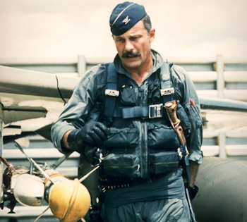 Col. Robin Olds preflights his F-4C Phantom before a mission in Southeast Asia duing 1967. He was the commander of the 8th Tactical Fighter Wing at Ubon Air Base, Thailand, and was credited with shooting down four enemy MiG aircraft in aerial combat over North Vietnam. (U.S. Air Force photo)