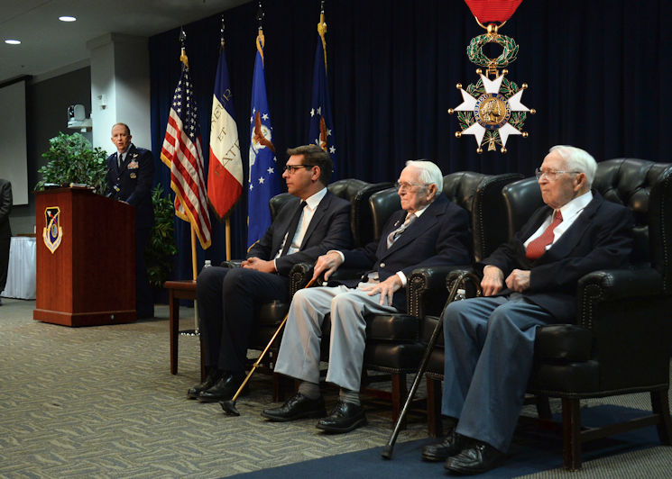 "December 2, 2015 - Maj. Gen. Robert D. McMurry Jr., the Space and Missile Systems Center vice commander, addresses the audience as Christophe Lemoine, the French consul general in Los Angeles, prepares to present identical twin brothers and retired Air Force Reserve Majs. Russell ""Lynn"" Clanin and Raymond ""Glenn"" Clanin with the French government's highest distinction for their military service as World War II veterans, the Legion of Honor medal. (Image created by USA Patriotism! from USAF photo by Van De Ha)"
