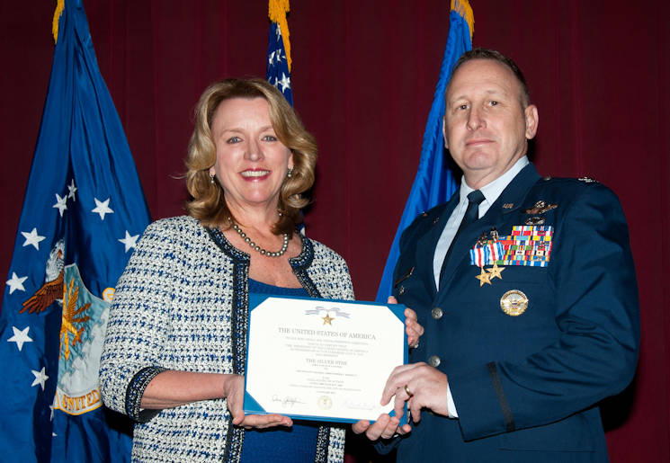 January 19, 2017 - Air Force Secretary Deborah Lee James presents Col. Christopher C. Barnett, an Air War College faculty member, the Silver Star and the Silver Star first oak leaf cluster. James chose her last day as the secretary of the Air Force to honor Barnett for his gallantry in connection with 2009 military operations, as well as to announce upgraded medals awarded to seven additional Airmen. (U.S. Air Force photo by Melanie Rodgers Cox)