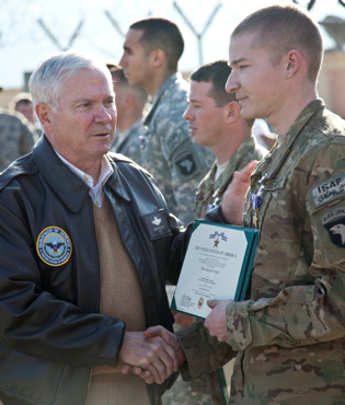 U.S. Army Cpl. Joshua Busch, 1st Battalion, 327th Infantry Regiment, is awarded the Silver Star Medal by the Secretary of Defense, the Honorable Robert Gates, Forward Operating Base Joyce, Konar province, Afghanistan, Dec. 7, 2010. The Silver Star was awarded for valorous actions against armed and heavily fortified enemy during Operation Strong Eagle.