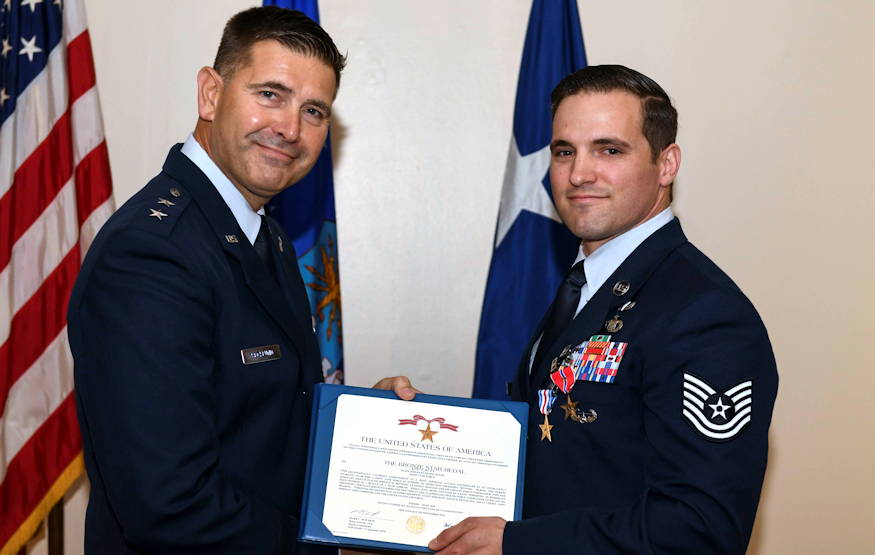 U.S. Air Force Maj. Gen. Vincent Becklund, left, deputy commander of Air Force Special Operations Command, presents U.S. Air Force Tech. Sgt. Cam Kelsch, a Special Tactics Tactical Air Control Party operator with the 17th Special Tactics Squadron, a Bronze Star Medal with Valor during a presentation ceremony at the Mighty Eighth Air Force Museum, Pooler, Georgia, April 9, 2019. The BSM with Valor was presented to Kelsch for actions while deployed with an interagency partner force to Afghanistan in 2018. (U.S. Air Force photo by Senior Airman Rachel Yates)
