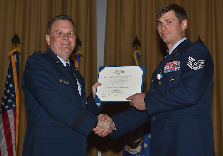 April 7, 2017- U.S. Air Force Lt. Gen. Brad Webb, the commander of Air Force Special Operations Command, presents U.S. Air Force Tech. Sgt. Brian C. Claughsey, a combat controller with the 21st Special Tactics Squadron, a Silver Star medal at Pope Army Airfield, NC. Following a 96-hour battle with Taliban forces in Kunduz, Afghanistan, Claughsey was credited with coordinating 17 close air engagements, resulting in 47 of the enemy killed in action without a single civilian or friendly casualty. U.S. Air Force photo by Senior Airman Ryan Conroy)