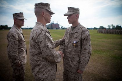 July 10, 2012 - Colonel Kenneth M. DeTreux, the commanding officer of 8th Marine Regiment, 2nd Marine Division, shakes the hand of Woodstock, Ga., native Lance Cpl. Jeffrey Cole (right) after presenting him with the nation's third highest award for valor, the Silver Star.  Courtesy photo by U.S. Marine Corps