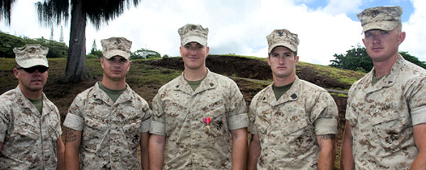 "After receiving a Bronze Star with a ""V"" device for valor July 6, 2010 at U.S. Marine Corps Forces, Pacific Headquarters, Camp H. M. Smith, Hawaii, Sgt. Michael G. Dowling (center) credited his team for his award. Dowling, a scout sniper currently serving as the noncommissioned officer in charge for Regional Operations and Plans, MarForPac, was recognized for his actions while serving in Afghanistan as a scout sniper team leader. (Dowling's team, from left to right) Lance Cpl. Will Betts, Cpl. Daniel Hilsdorf, Petty Officer 3rd Class Cory McGuire and Lance Cpl. Ken Cormier."