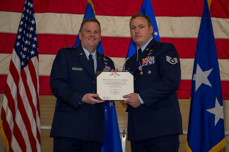 U.S. Air Force Staff Sgt. Christopher Lewis, a combat controller with the 23rd Special Tactics Squadron, receives the Silver Star Medal from U.S. Air Force Lt. Gen. Brad Webb, commander of Air Force Special Operations Command, during a ceremony at Hurlburt Field, Florida, Jan. 19, 2018. Lewis received the Silver Star for his actions during the Mosul offensive in Iraq in 2016, during the course of which he engaged with enemies at close range multiple times and called in four precision airstrikes, providing his team crucial air coverage and eliminating more than 20 enemy forces. (U.S. Air Force photo by Staff Sgt. Victor J. Caputo)