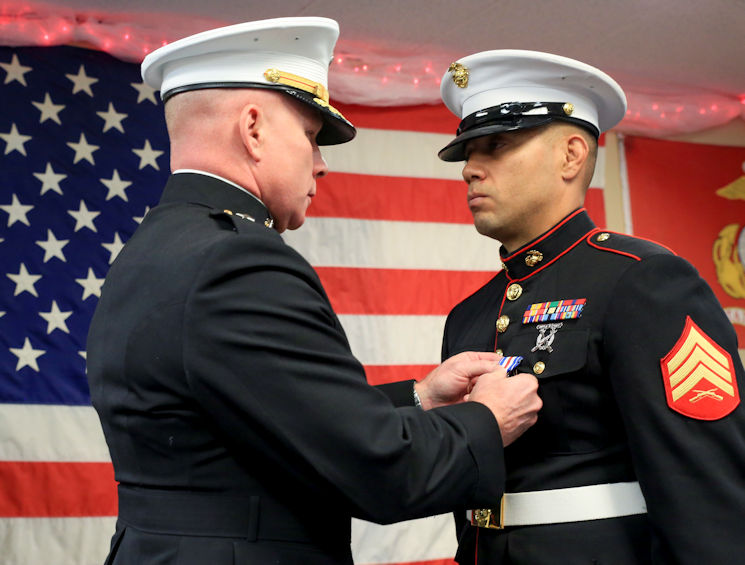 November 18, 2017 - Brig. Gen. Michael Martin, Deputy Commanding General of Marine Corps Forces Command, presents Marine Corps veteran Sgt. Eubaldo Lovato with the Silver Star award in Montrose, Colorado. Lovato received an award upgrade from his previous Bronze Star for his heroic actions while serving as a squad leader with Company A, 1st Battalion, 8th Marine Regiment, 1st Marine Division, during Operation Al Fajr, part of Operation Iraqi Freedom, on Nov. 15, 2004. The Silver Star is the United States third-highest personal decoration for valor in combat. (U.S. Marine Corps photo by Pfc. Samantha Schwoch)