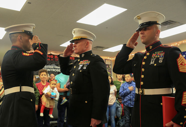 November 18, 2017 - Marine Corps veteran Sgt. Eubaldo Lovato (left), Silver Star recipient, Brig. Gen. Michael Martin (center), deputy commanding general of Marine Corps Forces Command, and Sgt. Maj. Bryan Fuller, Inspector Instructor Sgt. Maj. of Combat Logistics Battalion 453 Sgt. Maj., 4th Marine Logistics Group, render honors during the playing of the National Anthem during the Silver Star award ceremony in Montrose, Colo., Nov. 18, 2017. Lovato received an award upgrade, from his previous Bronze Star, for his heroic actions while serving as a squad leader with Company A, 1st Battalion, 8th Marine Regiment, 1st Marine Division, during Operation Al Fajr, part of Operation Iraqi Freedom, on Nov. 15, 2004. The Silver Star is the United States third-highest personal decoration for valor in combat. (U.S. Marine Corps photo by Pfc. Samantha Schwoch)