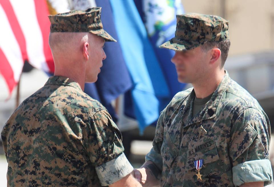 A Marine Raider was awarded the Silver Star Medal for heroic actions, while deployed to Afghanistan in 2019, at a ceremony aboard Marine Corps Base Camp Lejeune on July 10, 2020. The master sergeant and Critical Skills Operator, was serving as a Team Chief with 2nd Marine Raider Battalion in support of Operation Freedom's Sentinel when his team was engaged by enemy combatants. Note... The Marine Raider's name is withheld and face altered for security reasons. (U.S. Marine Corps photo by Gunnery Sgt. Lynn Kinney)