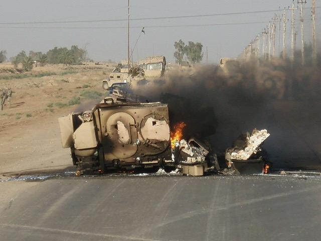 Then Staff Sgt. Curtis Reid's Bradley Fighting Vehicle burns after an explosively formed penetrator struck it southeast of Baghdad, Iraq, July 3rd, 2006. Reid, now a command sergeant major with 1st Battalion, 28th Infantry Regiment, 3rd Infantry Division, earned a Silver Star for his actions that day after rescuing numerous Soldiers from the vehicle. (U.S. Army courtesy photo by Command Sgt. Maj. Curtis Reid)