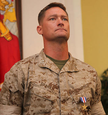 Captain Timothy R. Sparks, former company commander, 1st Battalion, 6th Marine Regiment, 2nd Marine Division, stands at the position of attention while his citation is read after receiving a Silver Star from Brig. Gen. W. Lee. Miller Jr., the acting commanding general of 2nd Marine Division, aboard Marine Corps Base Camp Lejeune N.C., September 28, 2011. The Silver Star is the nation's third highest award for combat valor and was presented to Sparks for his actions during his deployment to Helmand Province, Afghanistan in 2010. Photo by USMC Cpl. Johnny Merkley