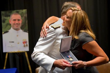 WASHINGTON, Sept. 23, 2011 – The nation's top military officer today presented a posthumous Silver Star to the widow of a heroic Navy officer who was killed in Afghanistan.