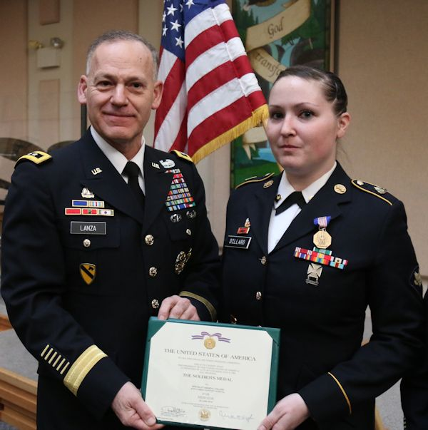 Spc. Amanda Dilliard, 62nd Medical Brigade, 593rd Expeditionary Sustainment Command, is awarded the Soldier's Medal by Lt. Gen. Stephen Lanza, I Corps commanding general, during a ceremony March 6, 2015. Dilliard aided in the rescue of Andrew Klakken, who was involved in a car accident. (U.S. Army photo by Staff Sgt. Wayne Diaz)