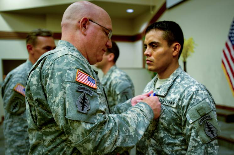 October 8, 2014 - U.S. Army Sgt. Carlos Torres, right, is pinned the Soldier's Medal by Brig. Gen. Michael Turello, deputy commander of the 1st Special Forces Command (Airborne) (Provisional). Torres, a resident of Fort Walton Beach, Fla., rescued an incapacitated soldier from a burning vehicle while the 7th Special Forces Group (Airborne) was stationed at Fort Bragg. (U.S. Army photo by Sgt. 1st Class Corey Vandiver)