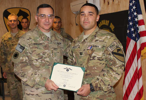 Capt. Dennis Edwards (right), an operations officer assigned to Task Force Lobos, 1st Air Cavalry Brigade, 1st Cavalry Division, originally from Baton Rouge, La., and recipient of the Soldier's Medal, the Army's highest peacetime award for valor, poses with Lt. Gen. Curtis Scaparrotti, commander, ISAF Joint Command, following the award presentation ceremony Dec. 1, 2011 here. Edwards received the award for his efforts to extract two drivers whose vehicles had caught fire during a traffic accident in Killeen, Texas on the morning of Jan. 27, 2011, according to the citation. Edwards ran to the scene, pulled the first driver out of the passenger side door, then went to the second vehicle, which was catching fire as well and extracted the second driver with the help of a few individuals who happened to be within the vicinity. Photo by Army Staff Sgt. Joe Armas
