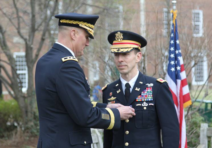 April 18, 2014 - Col. Everett Spain is presented the Soldier's Medal, the U.S. Army's highest peacetime decoration for heroism, by Maj. Gen. William Rapp, chief, Army Legislative Liaison. Spain received the award for heroism for actions taken one-year prior at the scene of the Boston Marathon bombing on April 15, 2013, where he distinguished himself following the two blasts by immediately and selflessly rushing toward the threat without regard to his own personal safety; rendering first aid until medical help arrived despite the potential for additional explosive devices. (Courtesy Photo by U.S. Army Corps of Engineers)