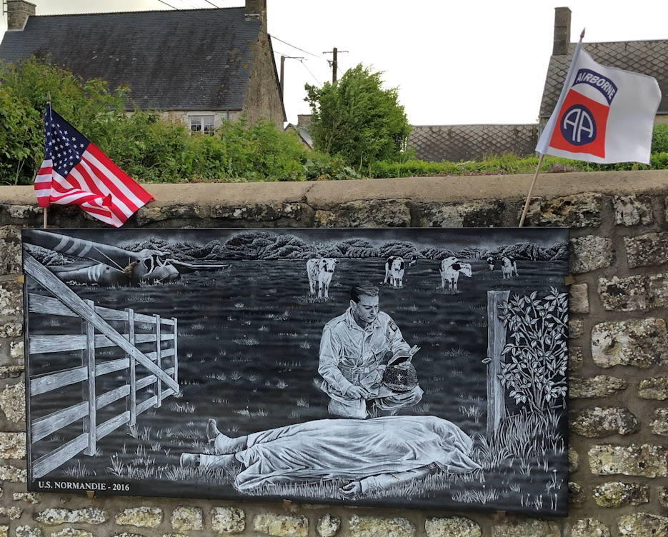 The monument dedicated to Capt. Ignatius Maternowski in the town of Guetteville, France on June 8, 2019. The monument depicts Maternowski saying the last rights to an American Paratrooper during the Normandy Invasion. (U.S. Army photo by Sgt. 1st Class Daniel Wallace)