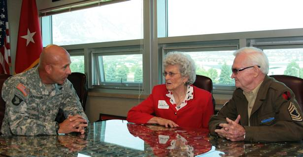 Maj. Gen. Joseph Anderson, commanding general of the 4th Infantry Division and Fort Carson, Colo., talks with Darlene and John Krajeski, July 11, 2012, in his office at the 4th Inf. Div. headquarters building. Photo by Andrea Sutherland, Fort Carson