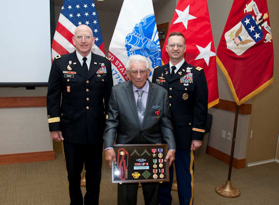 Mark Paradise, World War II veteran, poses for a photo with Maj. Gen. Gregg Martin, Army War College commandant, and Col. Karl Ginter, Army war College faculty on April 11, 2012. Ginter was capturing the memories of his father's friend, Pfc. Mark Paradise, when he recognized that Paradise had earned more than he had received when it came to Army awards and decorations. Ginter conducted the necessary research and paperwork resulting in receiving these special awards. U.S. Army photo