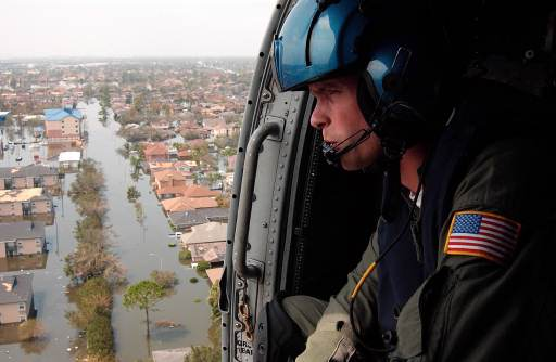 NEW ORLEANS (Aug. 30, 2005) - Coast Guard Petty Officer 2nd Class Shawn Beaty, 29, of Long Island, N.Y., looks for survivors in the wake of Hurricane Katrina here today. Beaty is a member of an HH-60 Jayhawk helicopter rescue crew sent from Clearwater, Fla., to assist in search and rescue efforts.