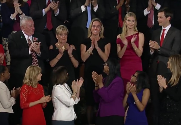 "During President Donald Trump' address to Joint Session of Congress on February 28, 2017,  the President and members of Congress applaud the widow of U.S. Navy SEAL William ""Ryan"" Owens, who was killed in a counterterrorism raid in Yemen earlier in 2017. The President honored Ryan Owens for his valor and ultimate sacrifice for the USA and fellow Americans. (Image created by USA Patriotism! from White House video of President Trump's address.)"