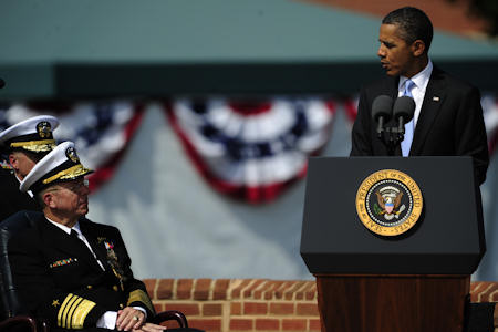 President Barack Obama congratulates chairman of the Joint Chiefs of Staff Adm. Mike Mullen during the Chairman of the Joint Chiefs of Staff change of responsibility ceremony on Joint Base Myer-Henderson Hall, Va., Sept. 30, 2011. Mullen was succeeded by Army Gen. Martin E. Dempsey, the 18th chairman of the Joint Chiefs of Staff, during the ceremony. DOD photo by U.S. Air Force Tech. Sgt. Jacob N. Bailey