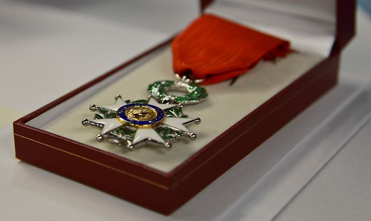 The French Legion D'Honneur, the highest decoration in France, lies on a table at a French National Day celebration in Tampa, Florida, July 14, 2014. Four World War II veterans received the medal for their service during the war. (U.S. Air Force photo by Airman 1st Class Ned T. Johnston)