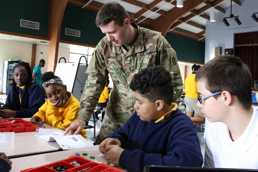 1st Lt. Robert Leisinger, executive officer for Delta Company, 3rd Battalion, 15th Infantry Regiment, 2nd Infantry Brigade Combat Team, 3rd Infantry Division, helps students put together a Lego robotics car at Snelson-Golden Middle School in Hinesville, Ga., November 15, 2016. Soldiers from 3-15th IN helped students with a personalized learning activity as part of the school's Science, Technology, Engineering, and Math program, STEM. (U.S. Army photo by Spc. Efren Rodriguez)