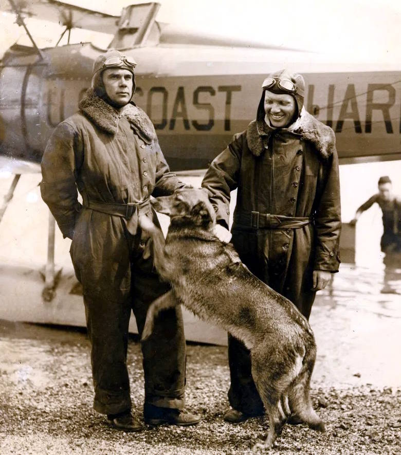 "LCDR C.C. von Paulsen, his dog ""Brutus"" and co-pilot ENS Leonard Melka, pose in front of a loaned Navy Vought UO-1 amphibian flown out of Squantum Naval Air Station in Quincy, Massachusetts. (Photo courtesy of the von Paulsen family)LCDR C.C. von Paulsen, his dog ""Brutus"" and co-pilot ENS Leonard Melka, pose in front of a loaned Navy Vought UO-1 amphibian flown out of Squantum Naval Air Station in Quincy, Massachusetts. (Photo courtesy of the von Paulsen family)"