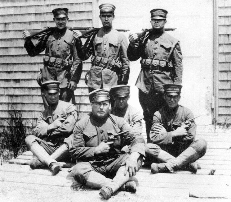 Coast Guard boat station crew at Quonocontaug, R.I., dressed in their World War I uniforms. (Coast Guard Collection)