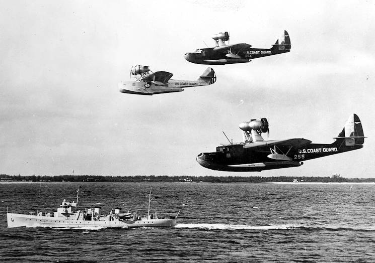 December 6, 1934 - Coast Guard planes (top to bottom - Flying Boat Acamar, Amphibian Sirius and Flying Boat Arcturus) from the Coast Guard Air Station Miami, Florida, greet the new 165-foot patrol boat Pandora upon her arrival station. (Photo from U.S. Coast Guard Collection)