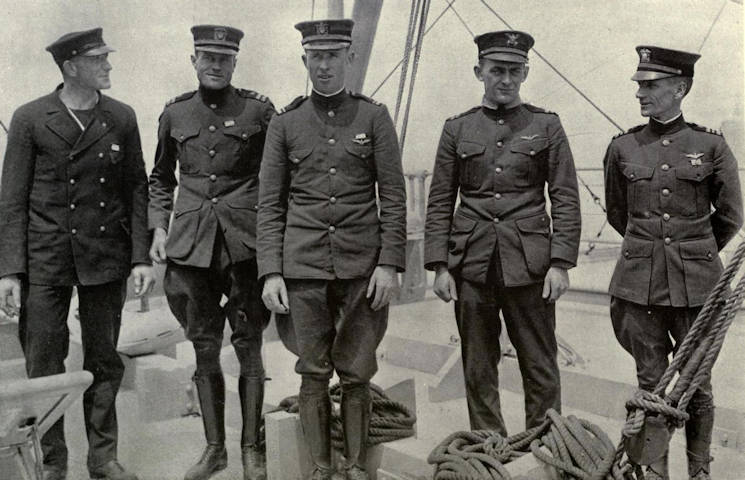 From left to right: Chief Mechanic E.C. Rhodes, USN; Lt. J.L. Breese, USNRF; Lt.(jg) W. Hinton, USN; Lt. E.F. Stone, USCG; Lt.Cmdr. A.S. Read, USN. Not pictured: H.C. Rodd ... U.S. Coast Guard NC-4 flight crew sometime after the first successful translatlantic test flight in 1919. (U.S. Navy courtesy photo)