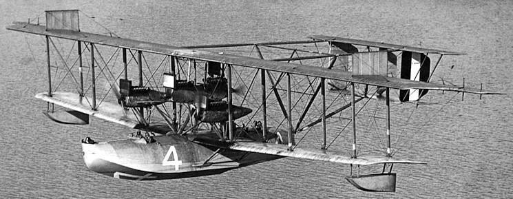 U.S. Coast Guard NC-4, a Curtiss NC seaplane (flying boat) under Navy caommand during World War I, sometime after the first successful translatlantic test flight in 1919. Visible is the fourth pusher engine which was added for that flight. (U.S. Navy courtesy photo)
