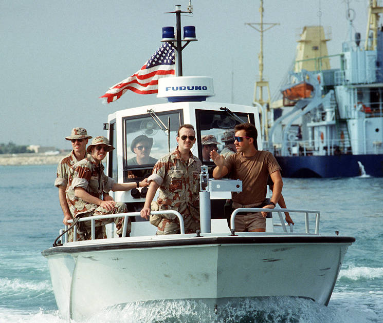 Members of U.S. Coast Guard Port Security Unit 302 patrol the harbor aboard a Navy harbor patrol boat during Operation Desert Shield in 1990. (U.S. Coast Guard photo)