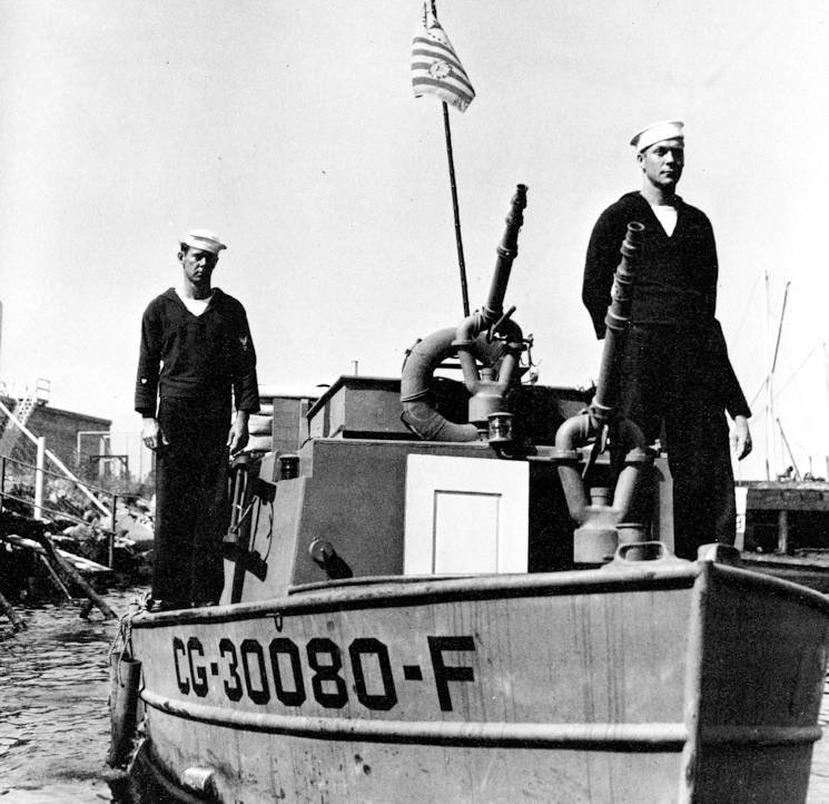 During the early stages of the firefighting, two of these water jet propelled 30-foot fireboats arrived at the El Estero, and began pouring water into the ammo ship along with local fire trucks and pier-side fire hoses. (U.S. Coast Guard photo)
