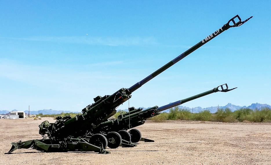 "April 13, 2016 - The M777A2 and M777ER side by side at a test site. Retrofitting an M777A2 howitzer into an M777ER—the ""ER"" stands for extended range ... only requires changing five components, which add little additional weight or cost. The long-range cannon project team is evaluating whether equipping artillery batteries with the extended-range howitzer plus new radar and tracking systems can increase their firepower while the Army develops more significant modernization solutions for long-range precision fires."