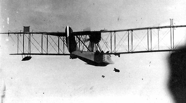 One of Chatham Air Station's HS-1 flying boats dropping its payload of two wing-mounted bombs. (Photograph courtesy of the National Archives)