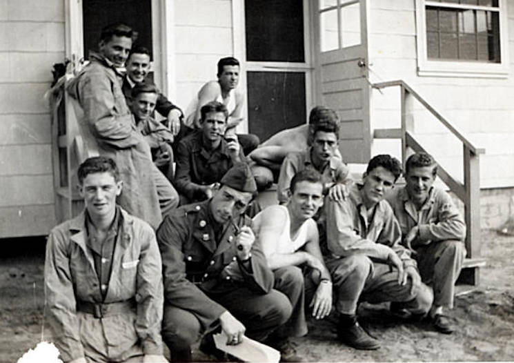 Aircraft mechanic students relax outside one of the dormitories in 1941, at Keesler Field, now known as Keesler Air Force Base, Miss. The dormitory was located south of where the present-day service station and shoppette are located. Thomas Adams Jr., a member of the first class of aircraft mechanic students at Keesler in 1941, made a visit to the base on December 7, 2011 on the 70th anniversary of the Japanese attack on Pearl Harbor. Adams was 90 at the time of his 2011 visit. (U.S. Air Force courtesy photo)