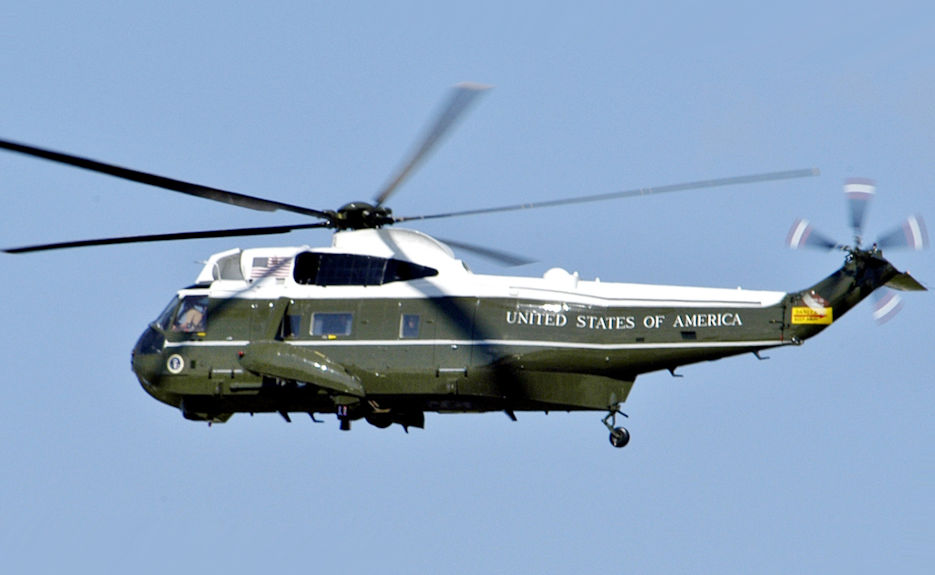 A U.S. Marine Corps Sikorsky VH-3D Sea King helicopter, assigned to Marine Helicopter Squadron 1 (HMX-1), in flight over Washington D.C. on 21 May 21, 2005. The VH-3D, designated Marine One, was flying U.S. president George W. Bush to the White House from Andrews Air Force Base, Maryland (USA) ... President Bush was returning from Grand Rapids, Michigan (USA), after giving a graduation speech to the 2005 graduates of Calvin College. (U.S. Marine Corps photo by Navy Photographer's Mate 2nd Class Daniel J. McLain)