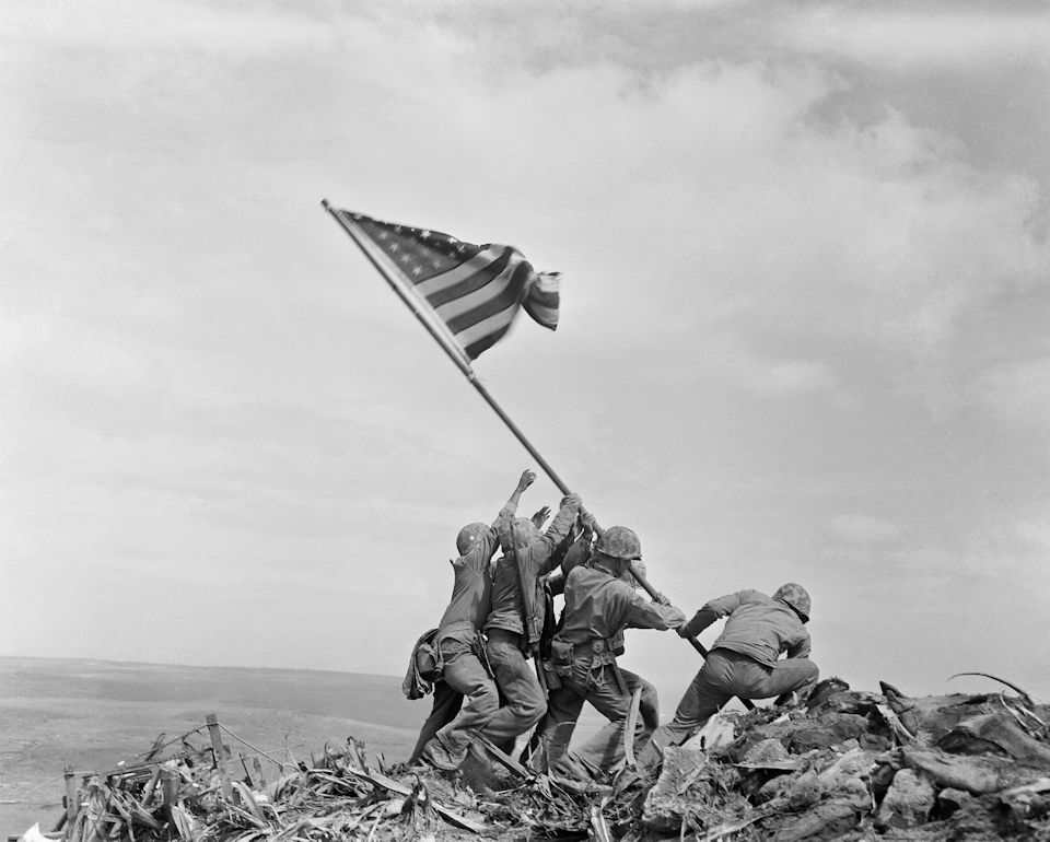 Raising the Flag on Iwo Jima is an iconic photograph taken by Joe Rosenthal on February 23, 1945, which depicts six United States Marines raising a U.S. flag atop Mount Suribachi during the Battle of Iwo Jima in World War II.