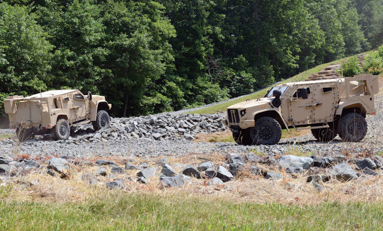 Joint Light Tactical Vehicles (JLTVs) perform demonstration runs around Marine Corps Base Quantico, Virginia, in June 2017. Army S&T programs are exploring ways to improve vehicle platforms by leveraging developments in artificial intelligence and advanced sensors to improve vehicle autonomy. (U.S. Army photo by David Vergun)